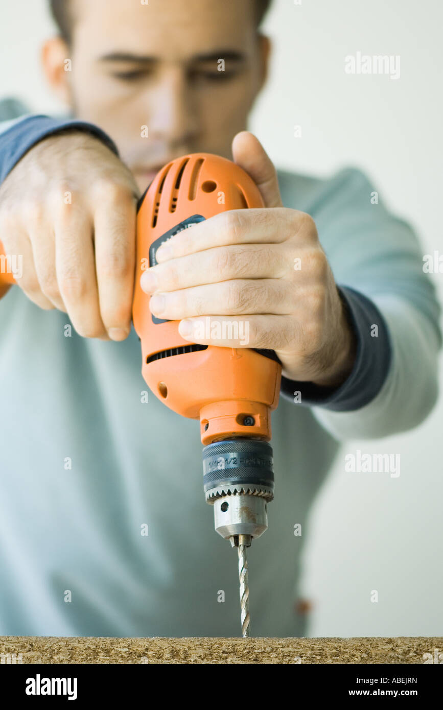 Man using drill - Stock Image