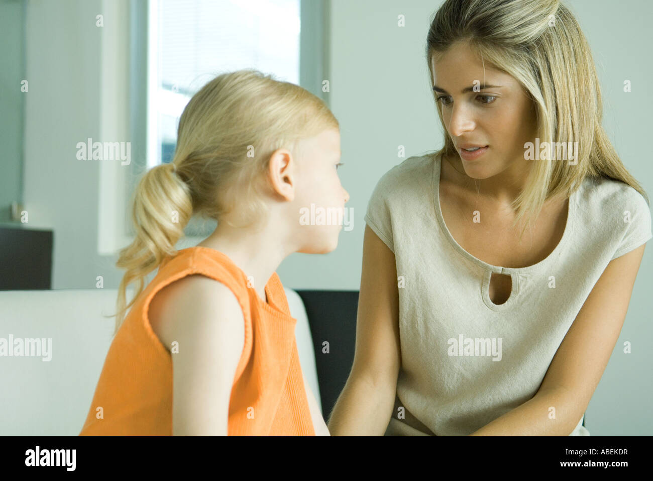 Mother and daughter talking together - Stock Image