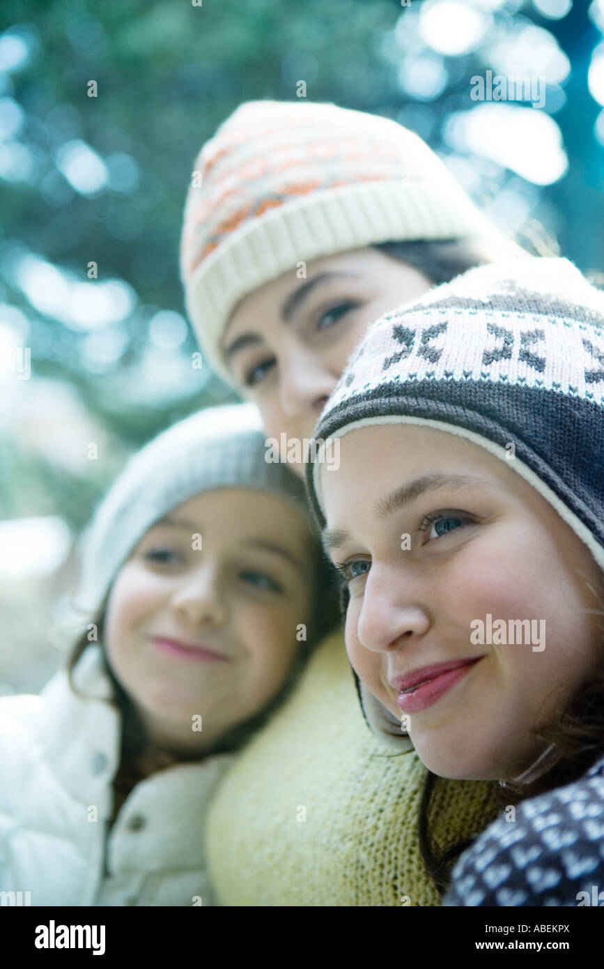 Young friends wearing winter clothing - Stock Image