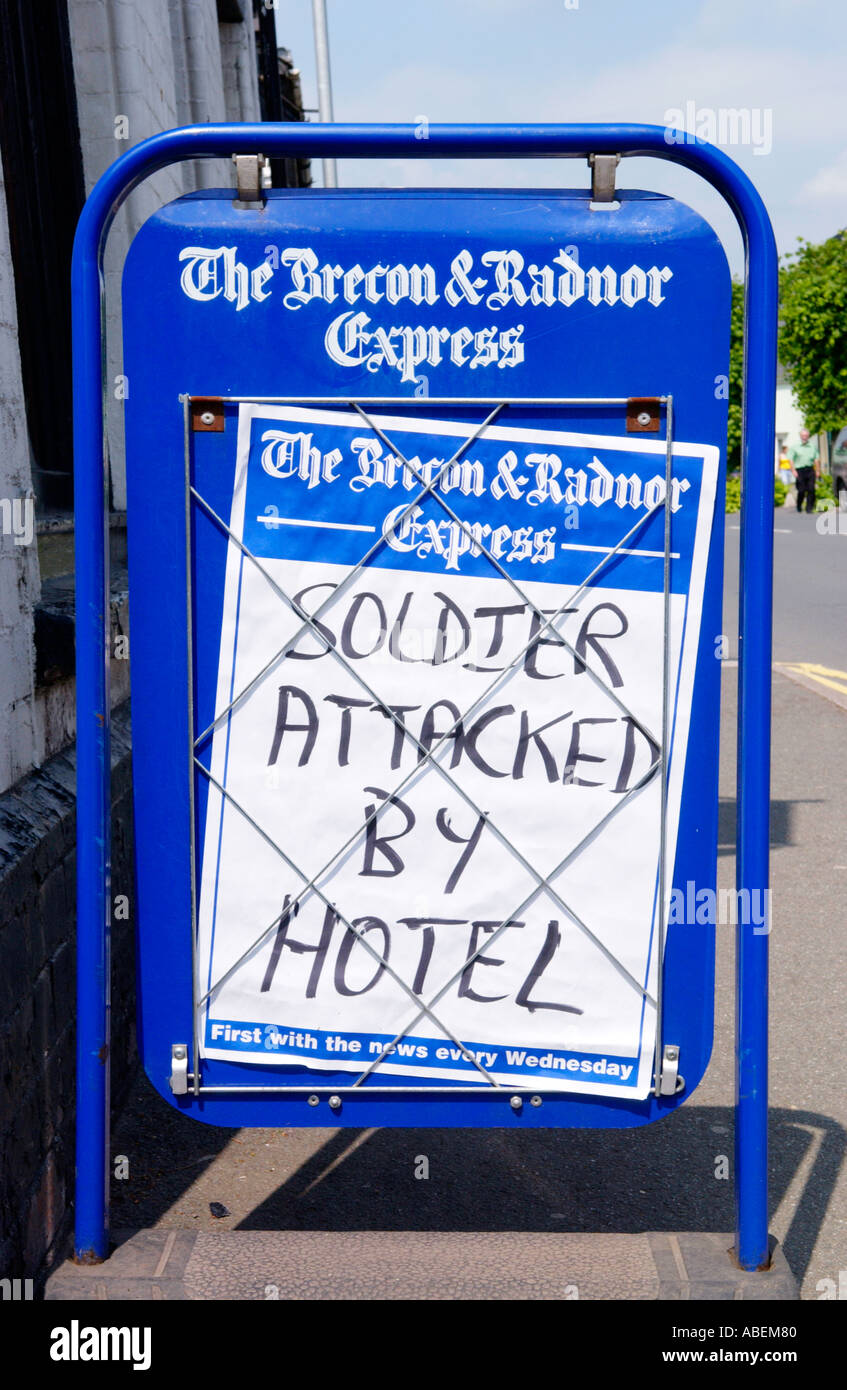 SOLDIER ATTACKED BY HOTEL newspaper headline outside newsagent's in town of Brecon Powys Wales UK - Stock Image