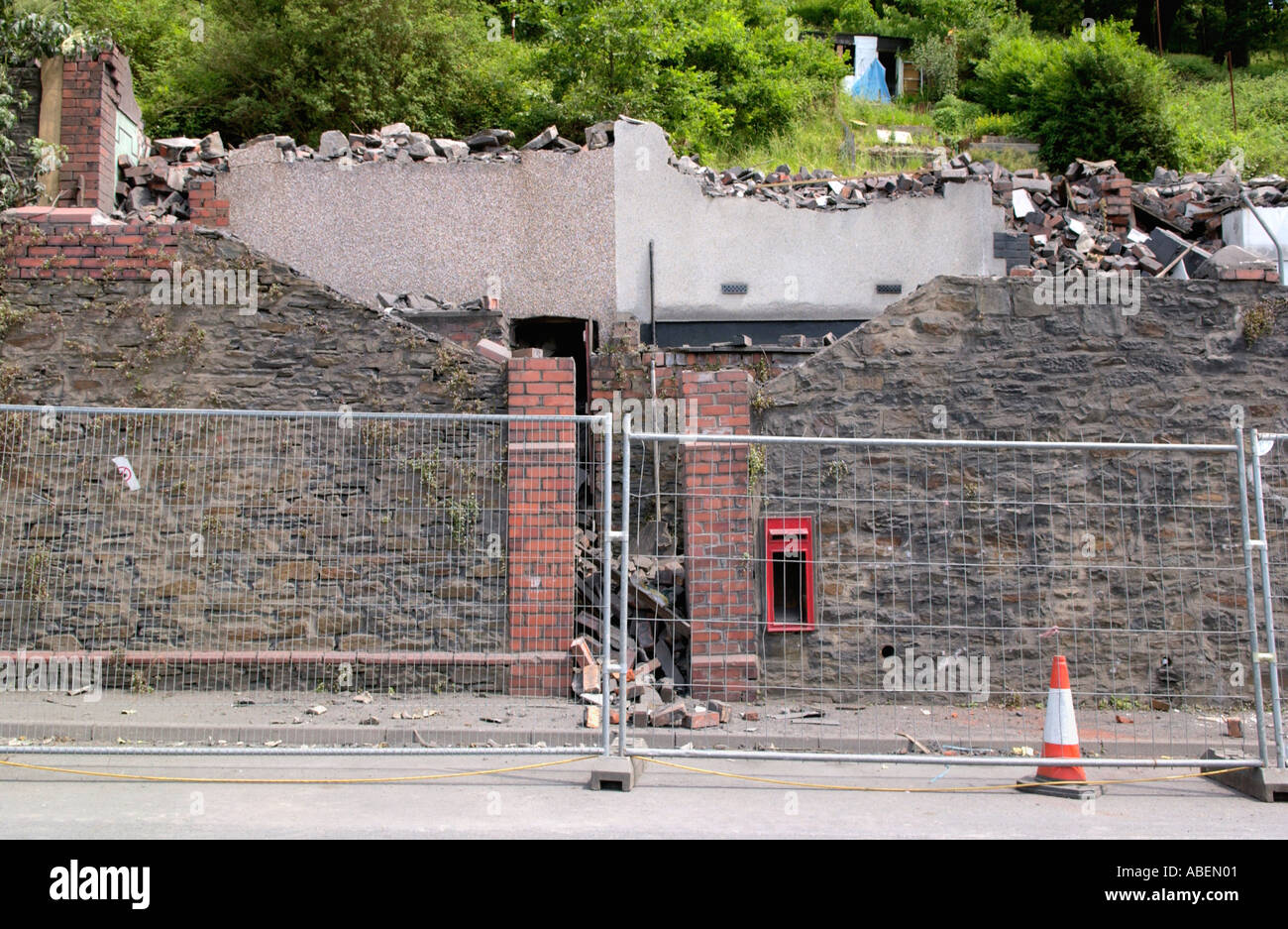 Terraced houses being demolished at Merthyr Vale near Merthyr Tydfil in the South Wales Valleys UK - Stock Image