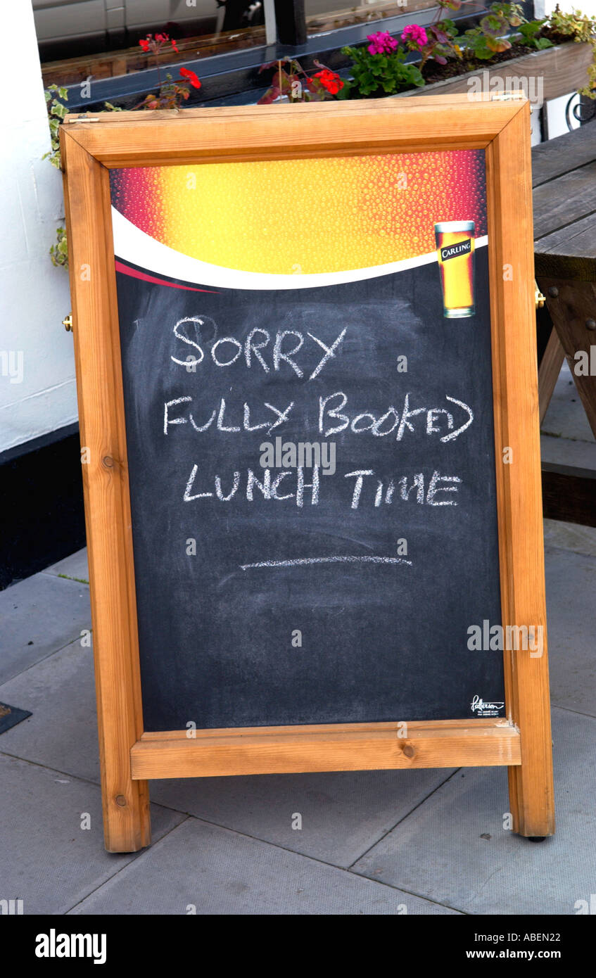 SORRY FULLY BOOKED LUNCH TIME Sign Outside Pub At Llanidloes Powys Mid Wales UK