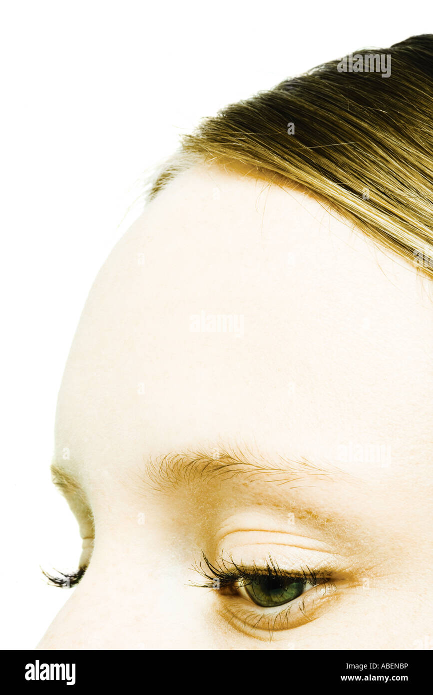 Teenage girl's forehead and eyes, close-up - Stock Image