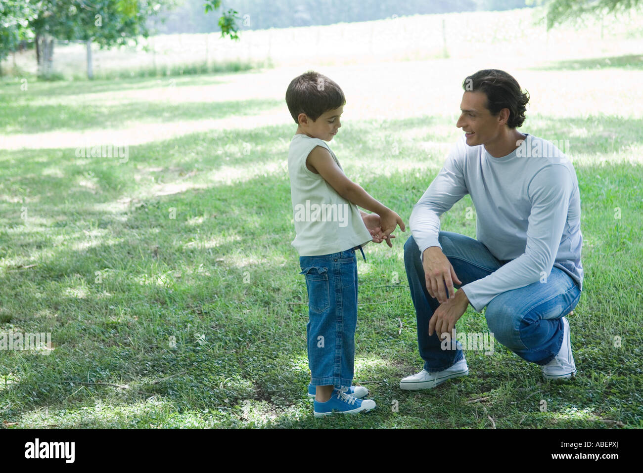 Boy and father talking outdoors - Stock Image