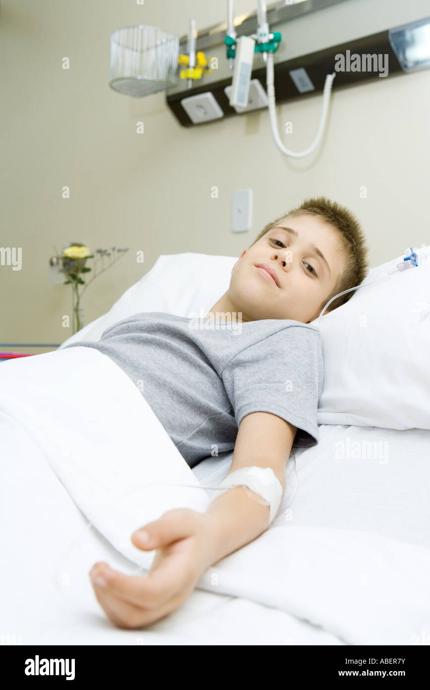 Boy lying in hospital bed Stock Photo