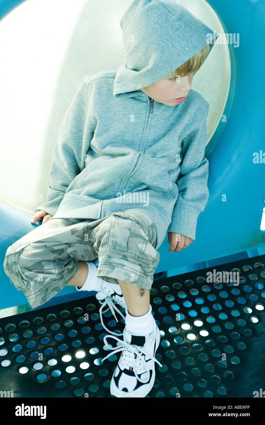 Child on playground equipment - Stock Image