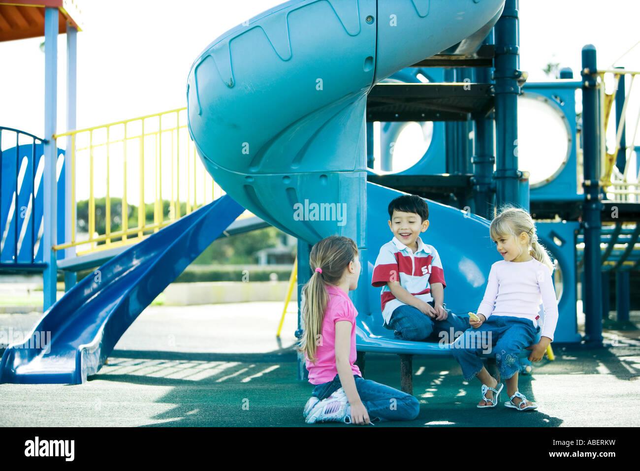 Children on playground equipment - Stock Image
