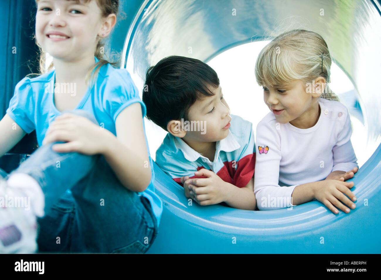 Children on playground equipment Stock Photo