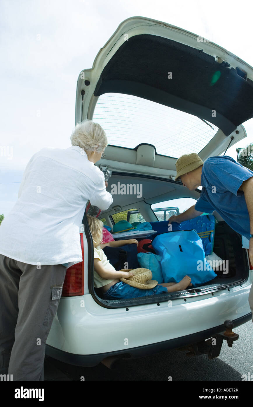 Family unloading trunk of car - Stock Image