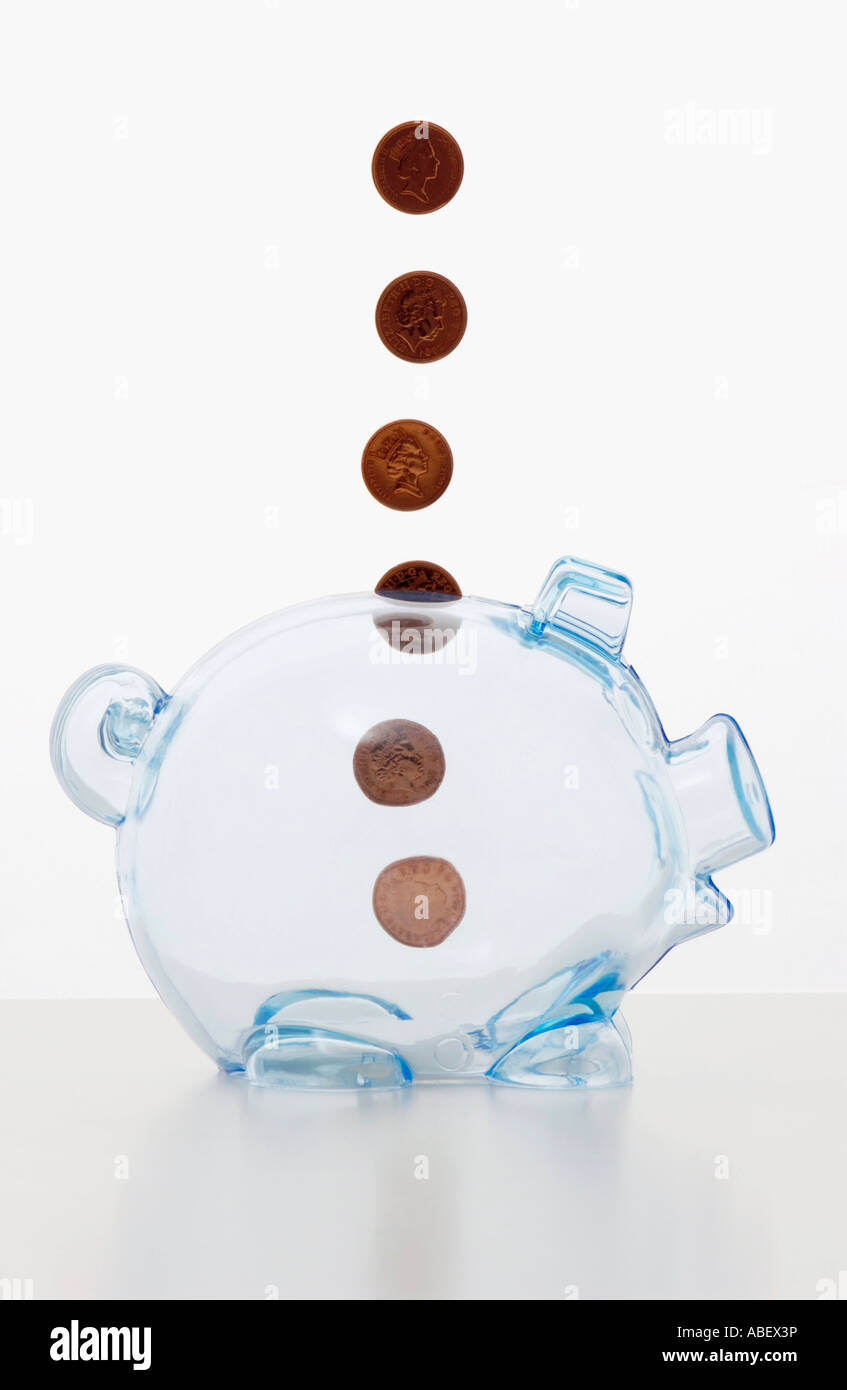 Clear plastic Pig Money Box suspended one penny coins - Stock Image
