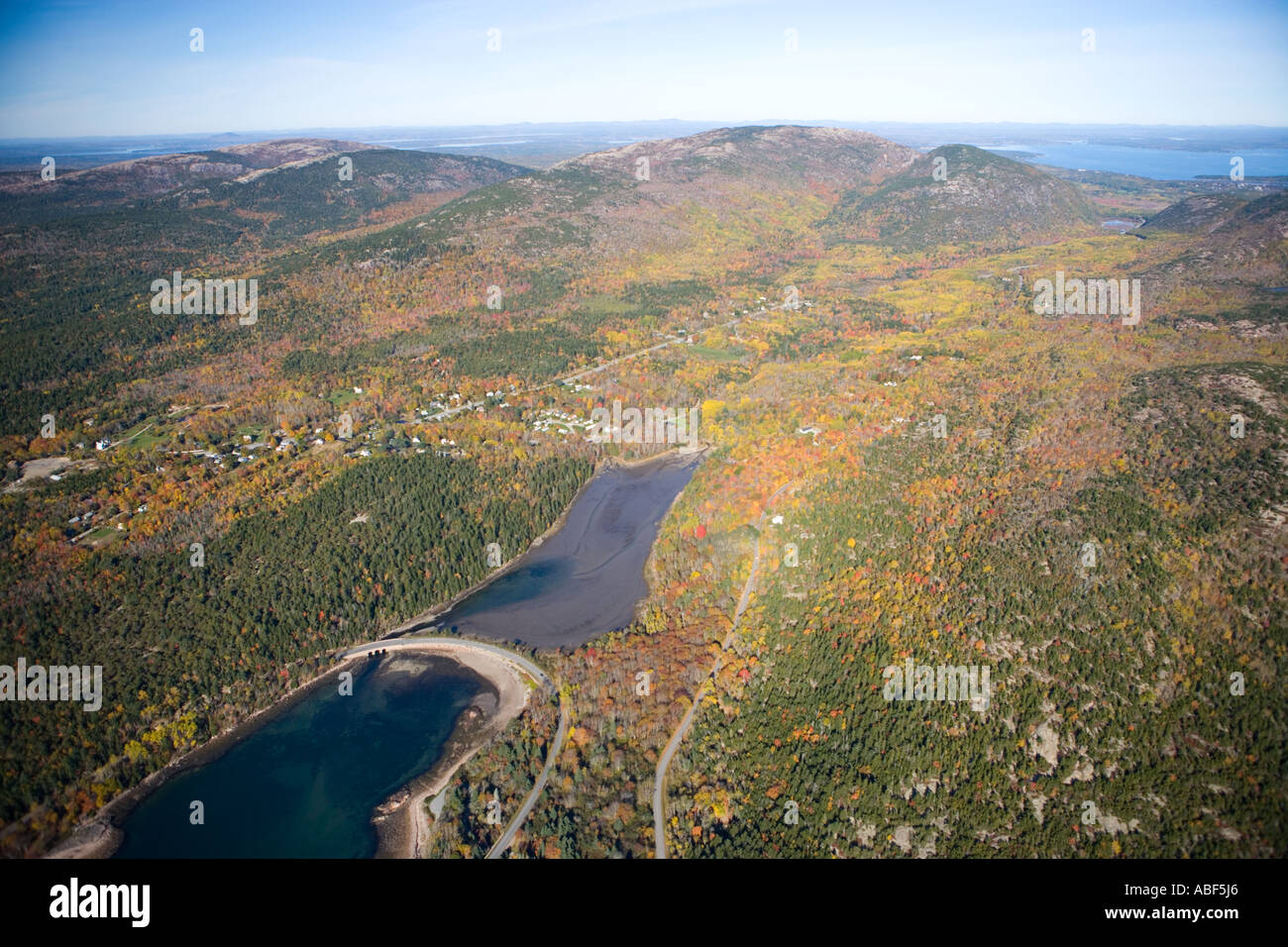 The park loop road curves across Otter Cove in Maine s Acadia National Park Stock Photo