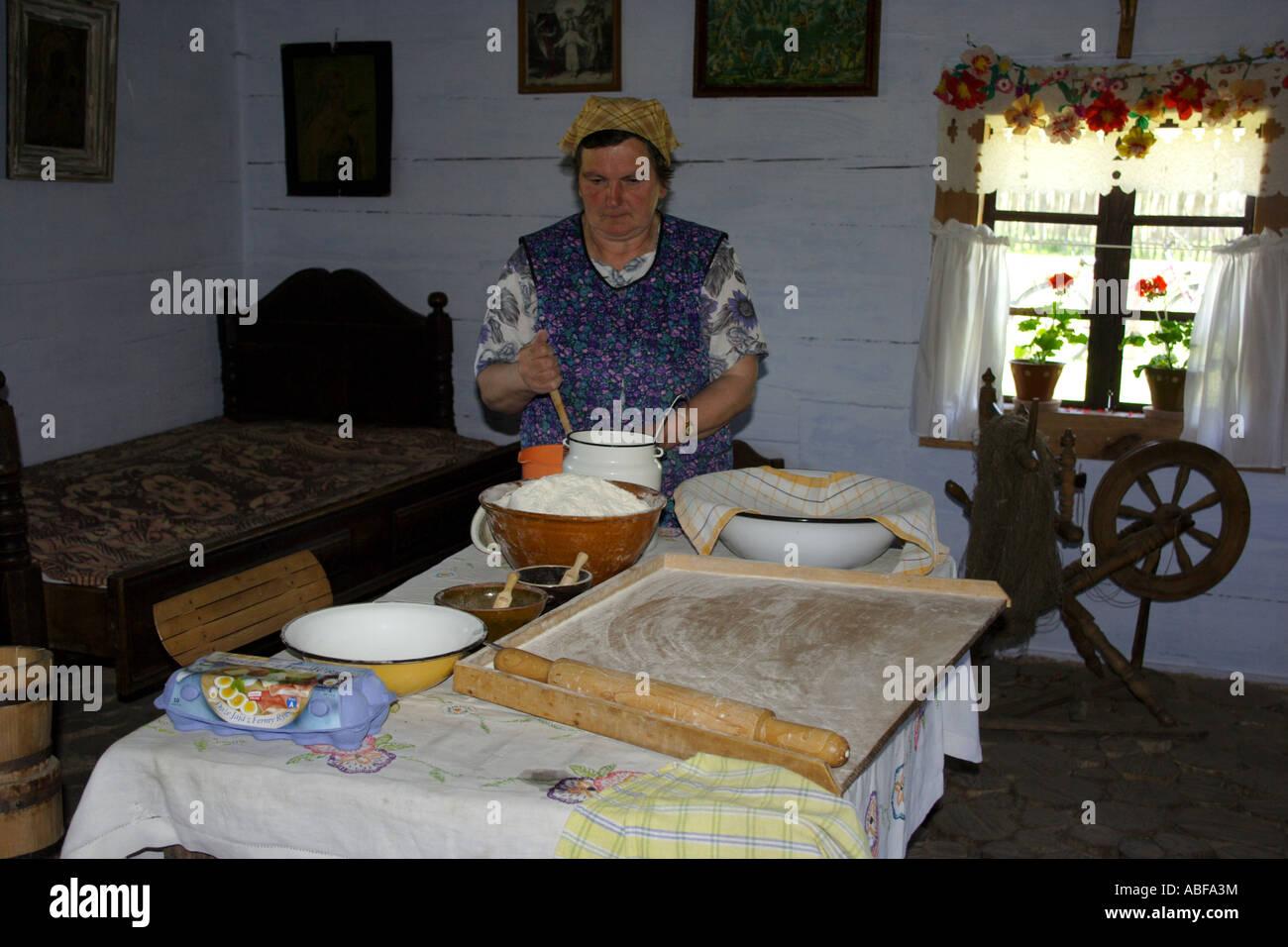 Woman preparing flat cake Guciow Poland Stock Photo