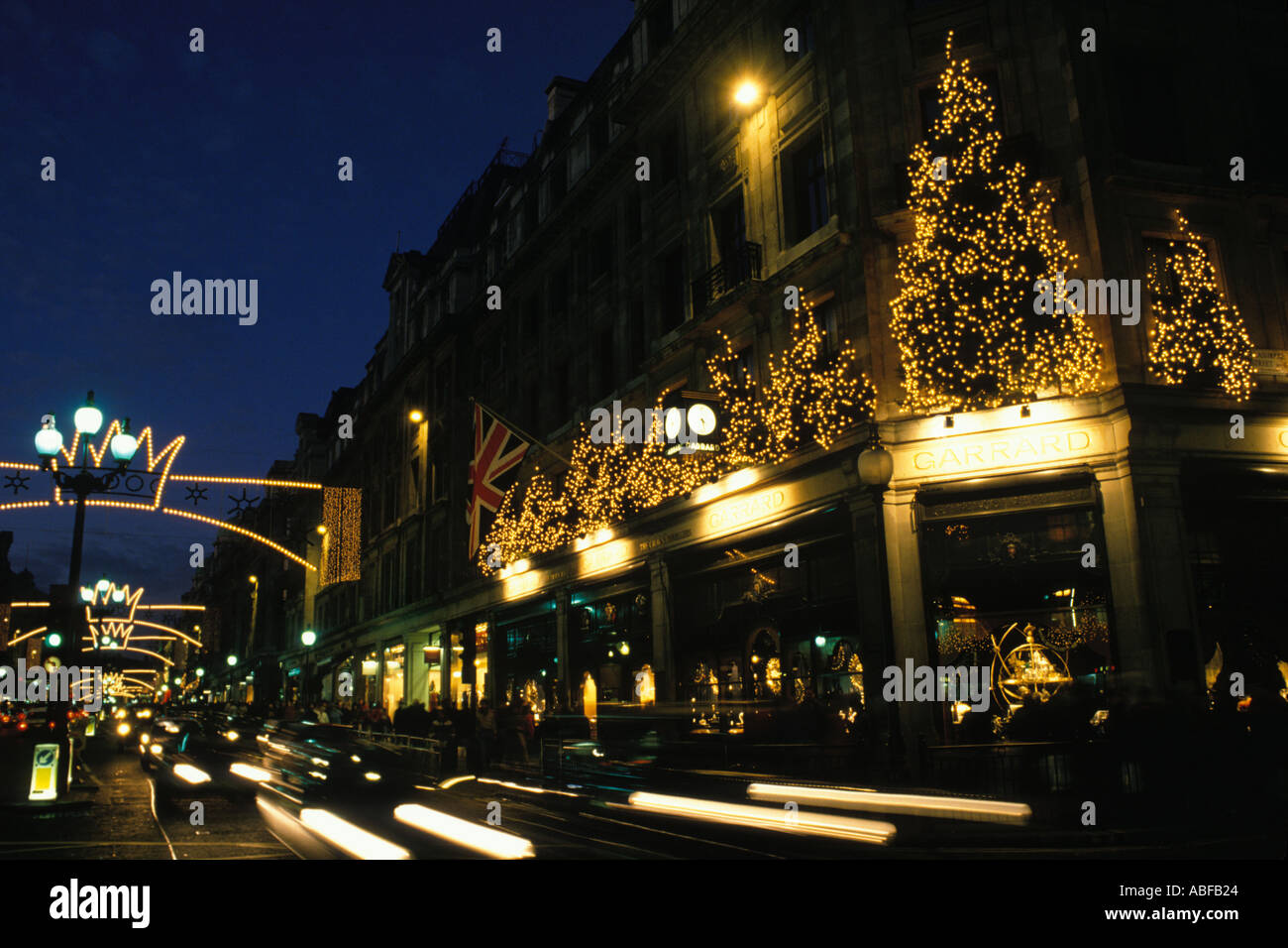garrards shop in regent street christmas lights and christmas tree above a retail shop london england