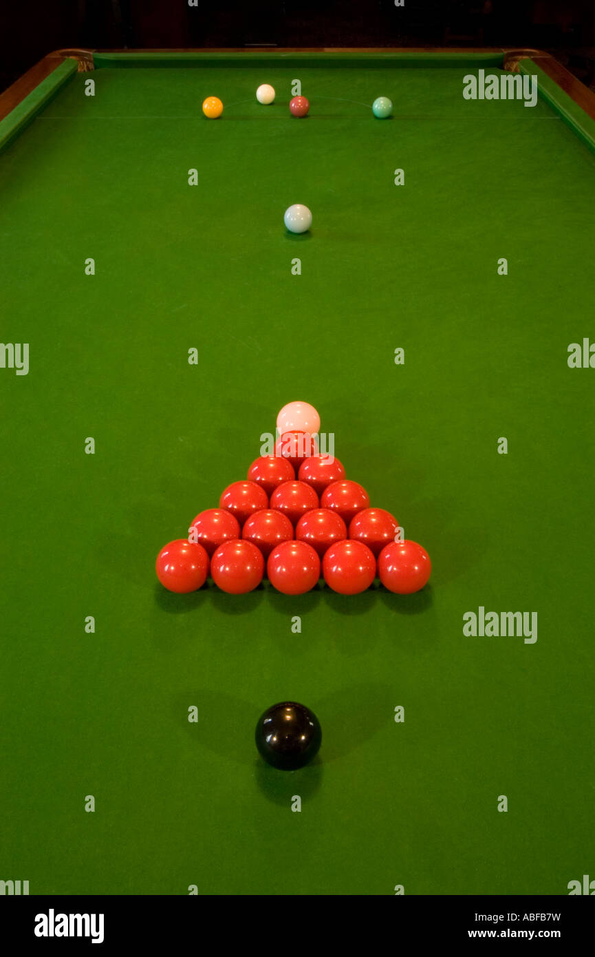a snooker table with balls set up ready to play in a pub or bar ...