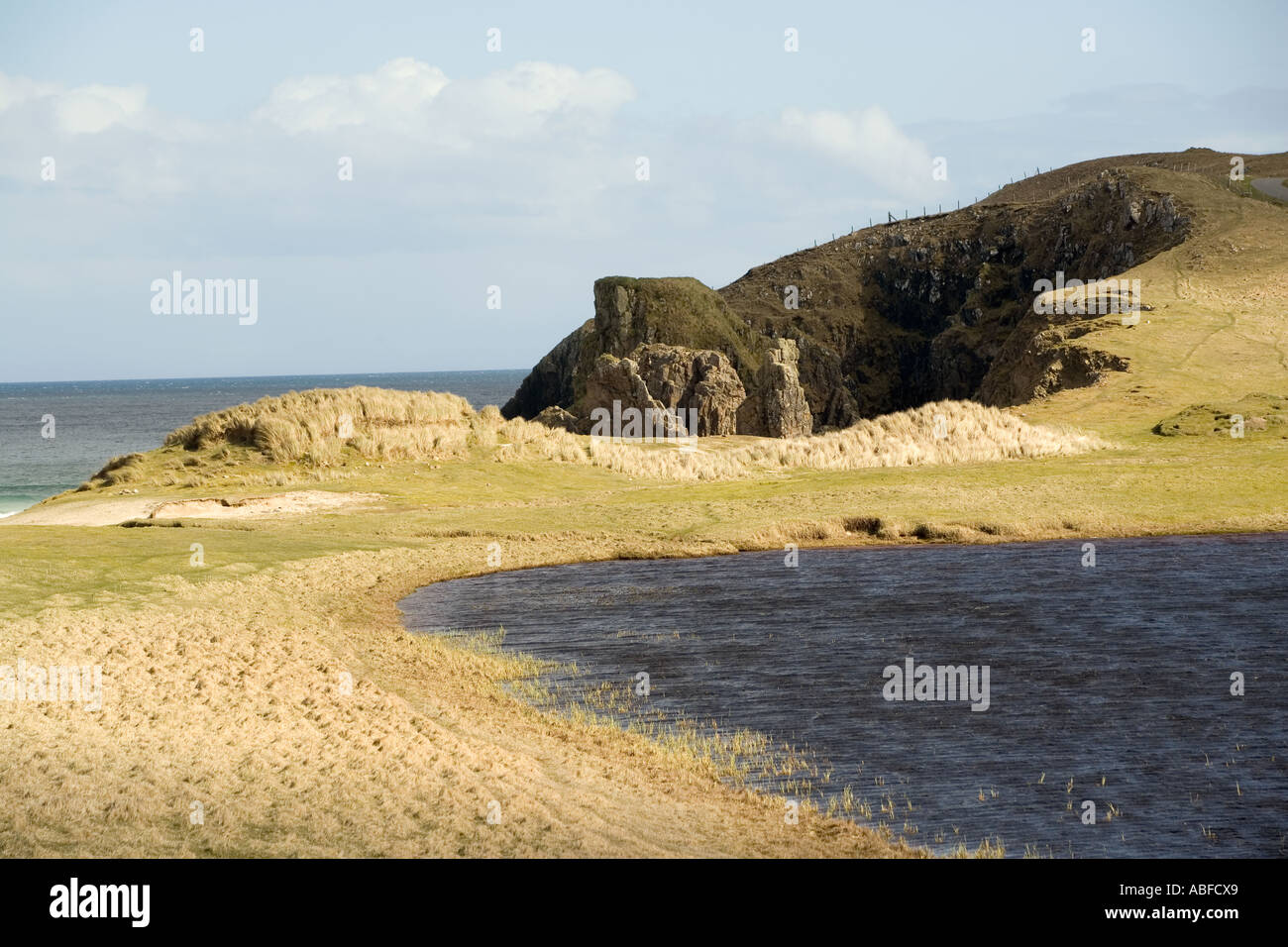 UK Scotland Western Isles Outer Hebrides Lewis Tolsta Traigh Ghearadha coastal loch and cliffs - Stock Image