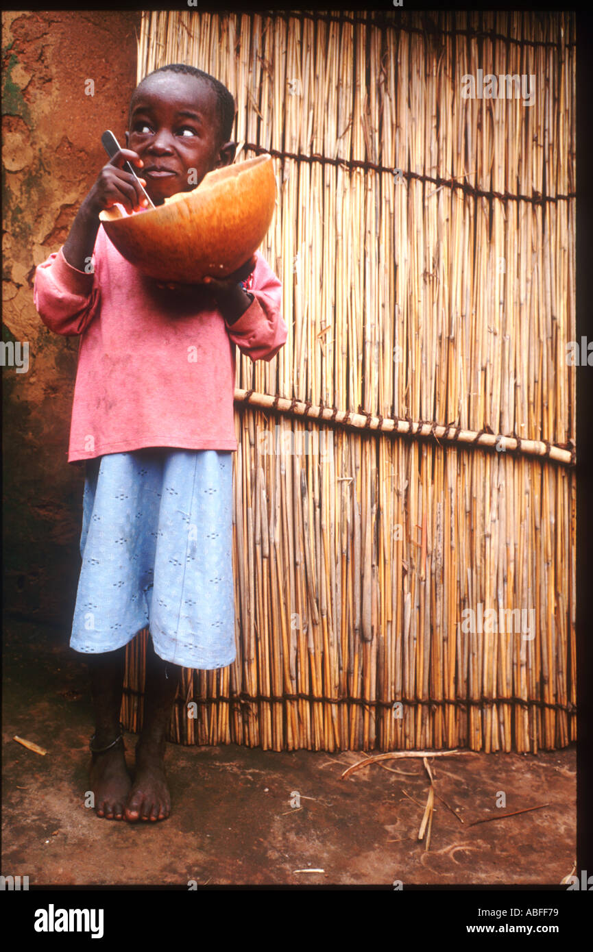 A Boy in Togoville eating his lunch Togoville is a village near Lake Togo in Togo  Stock Photo