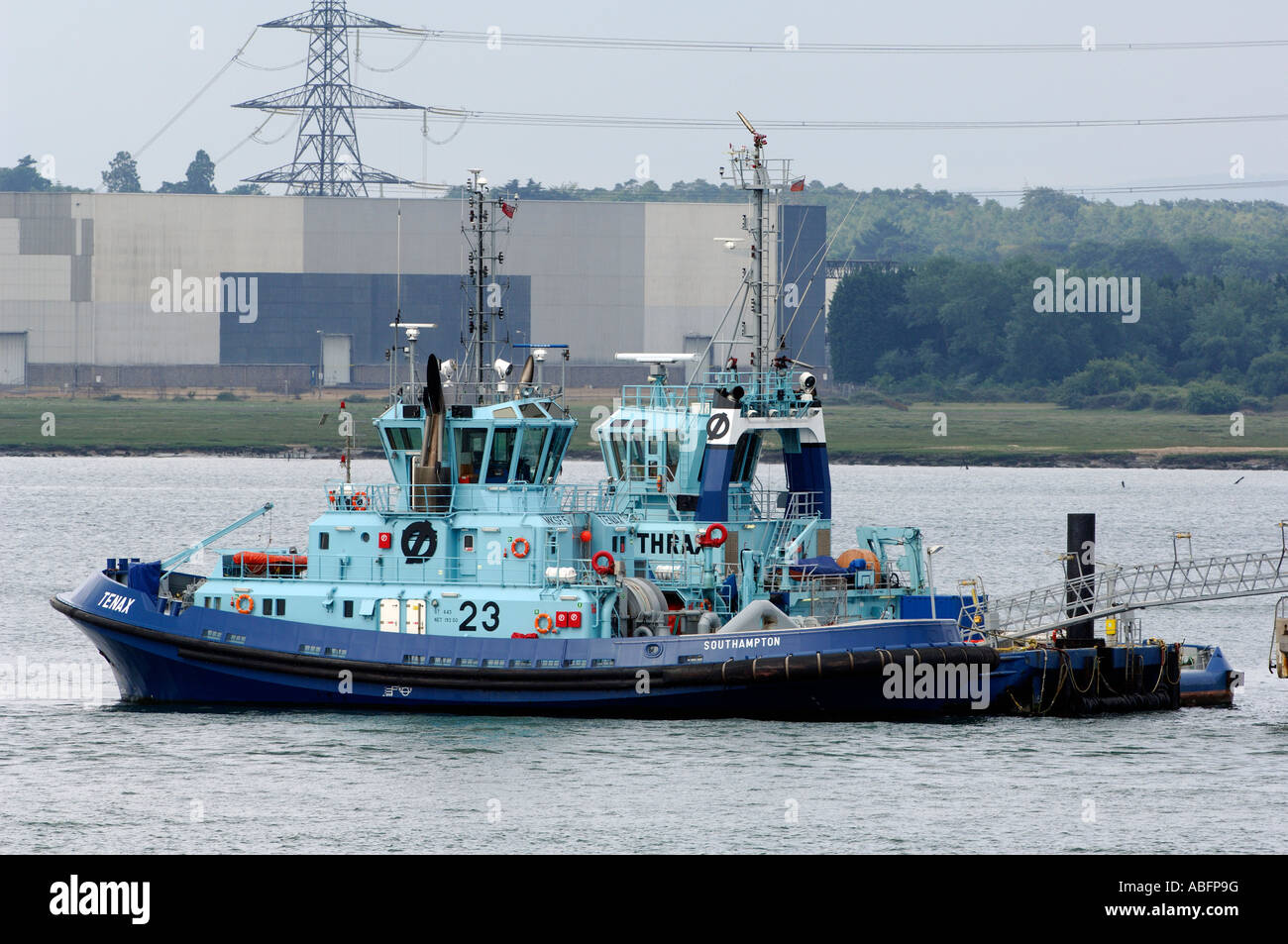 thrax and tenax tugs alongside at essso refinery fawley marine terminal hampshire marine berths solent towage - Stock Image