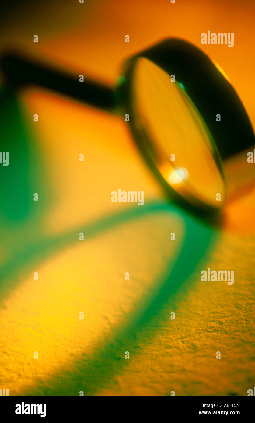 MAGNIFYING GLASS ON YELLOW BACKGROUND - Stock Image