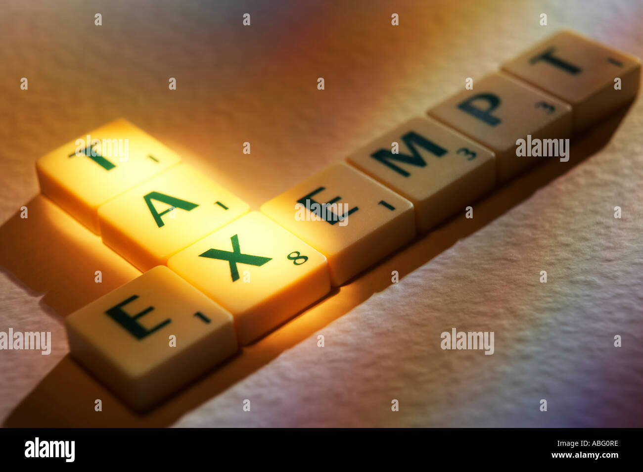 SCRABBLE BOARD GAME LETTERS SPELLING THE WORDS TAX EXEMPT - Stock Image