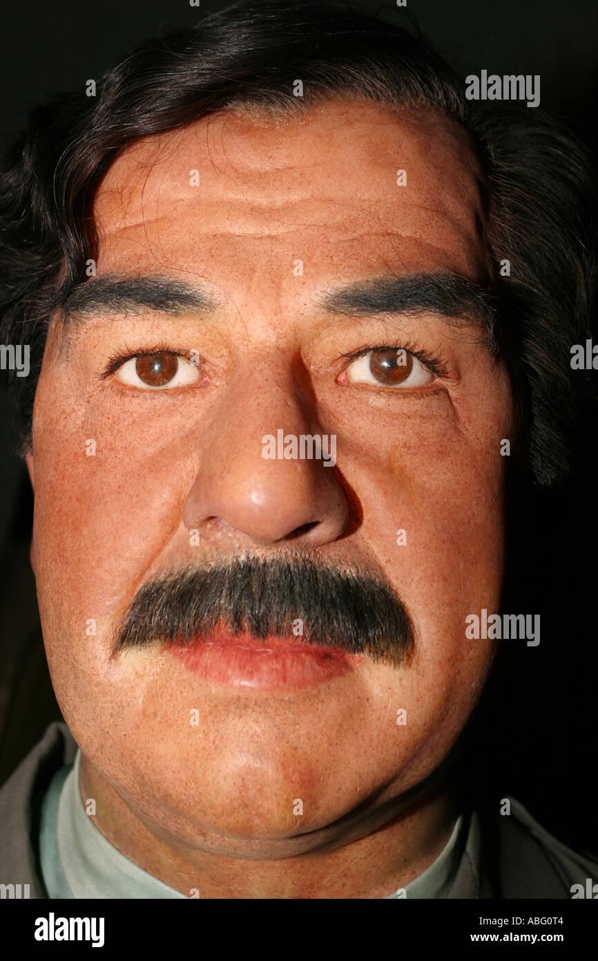 Saddam Hussein as a waxwork replica at Madame Tussauds, London - Stock Image