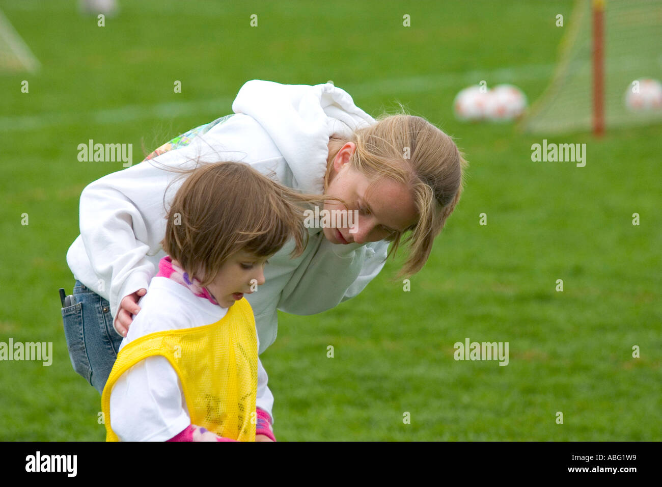 Mom Talking To Soccer Playing Daughter At The Game Age 22 And 4 Stock Photo Alamy