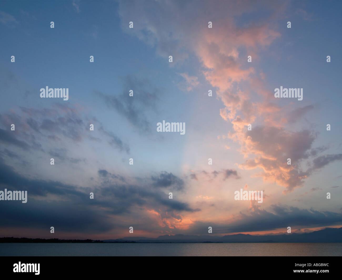 Beautiful cloud formation at sunset over Garda Lake Italy - Stock Image