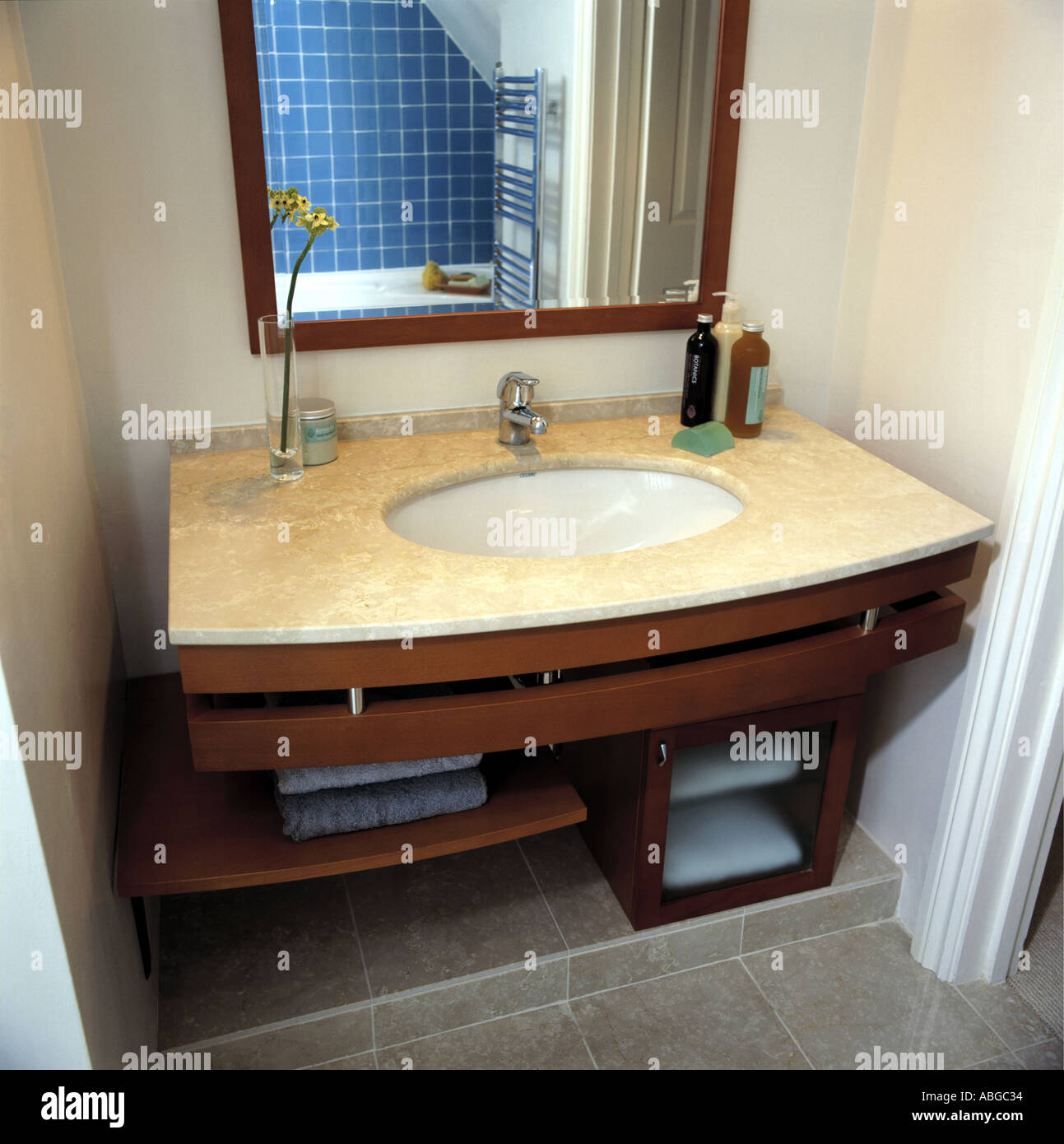 Mirror Above Bathroom Sink With Storage Underneath Stock Photo Alamy