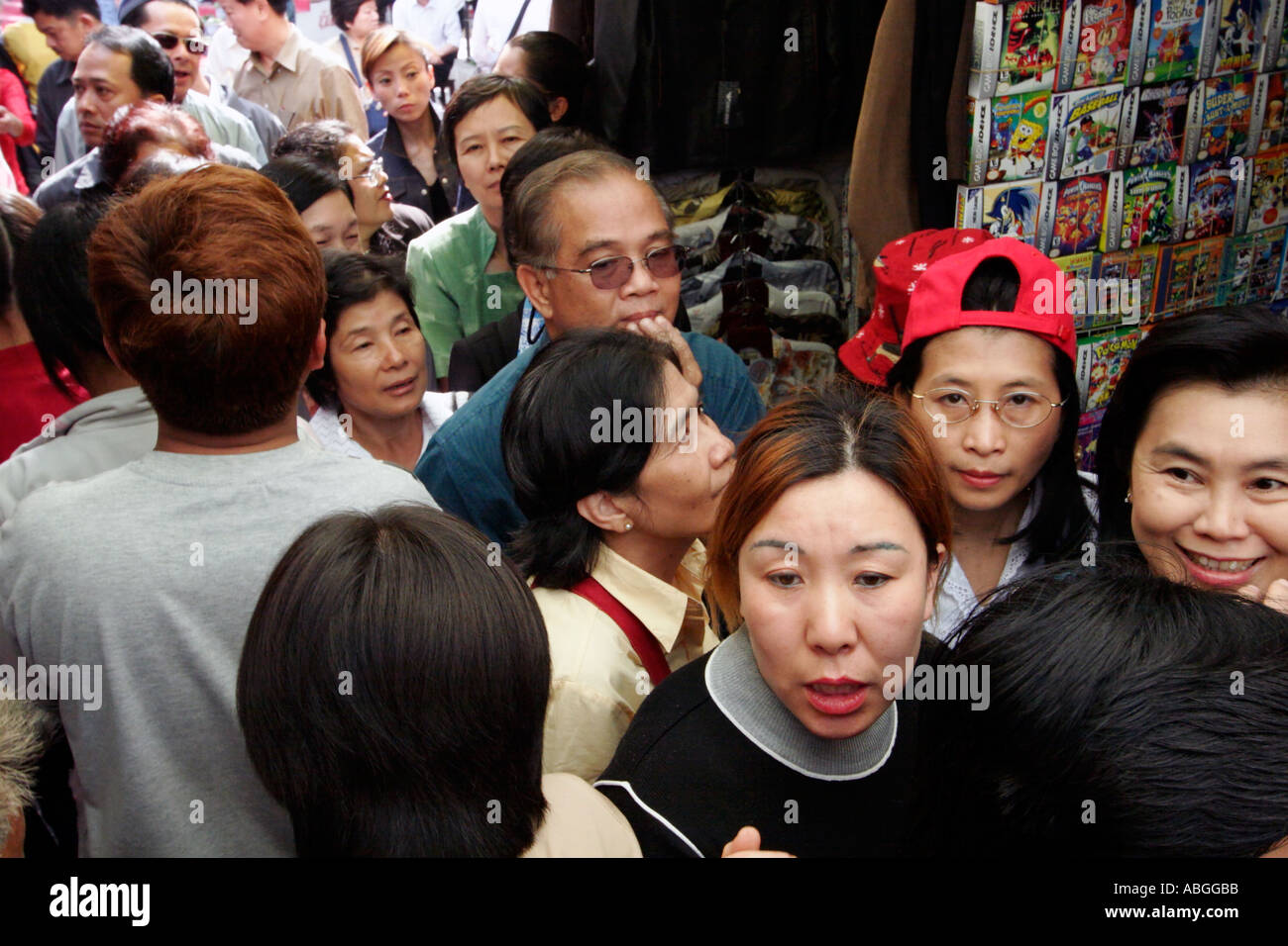 An open air market in Shanghai China is crowded with shoppers  - Stock Image