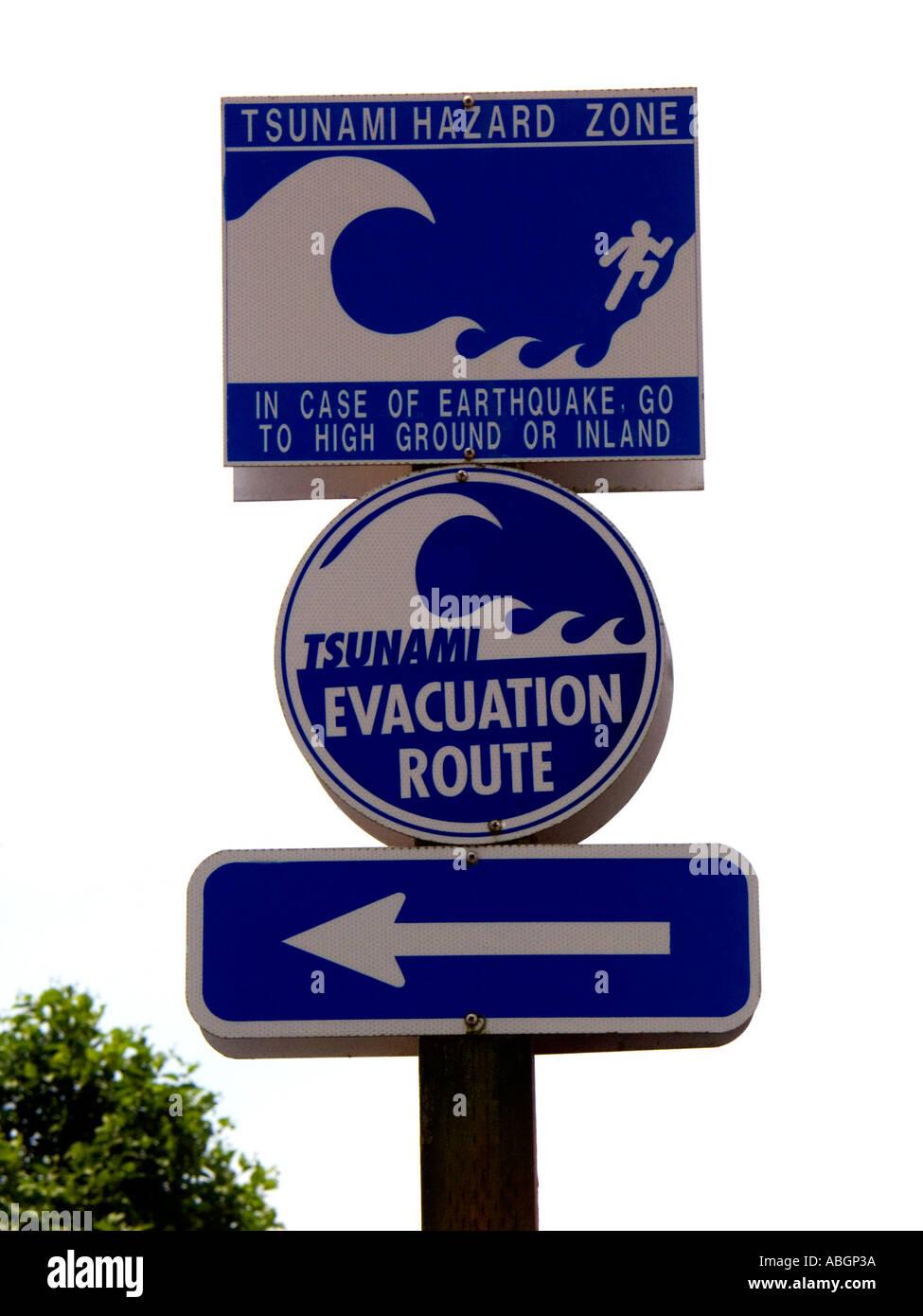 Tsunami warning and evacuation direction signs on Oregon