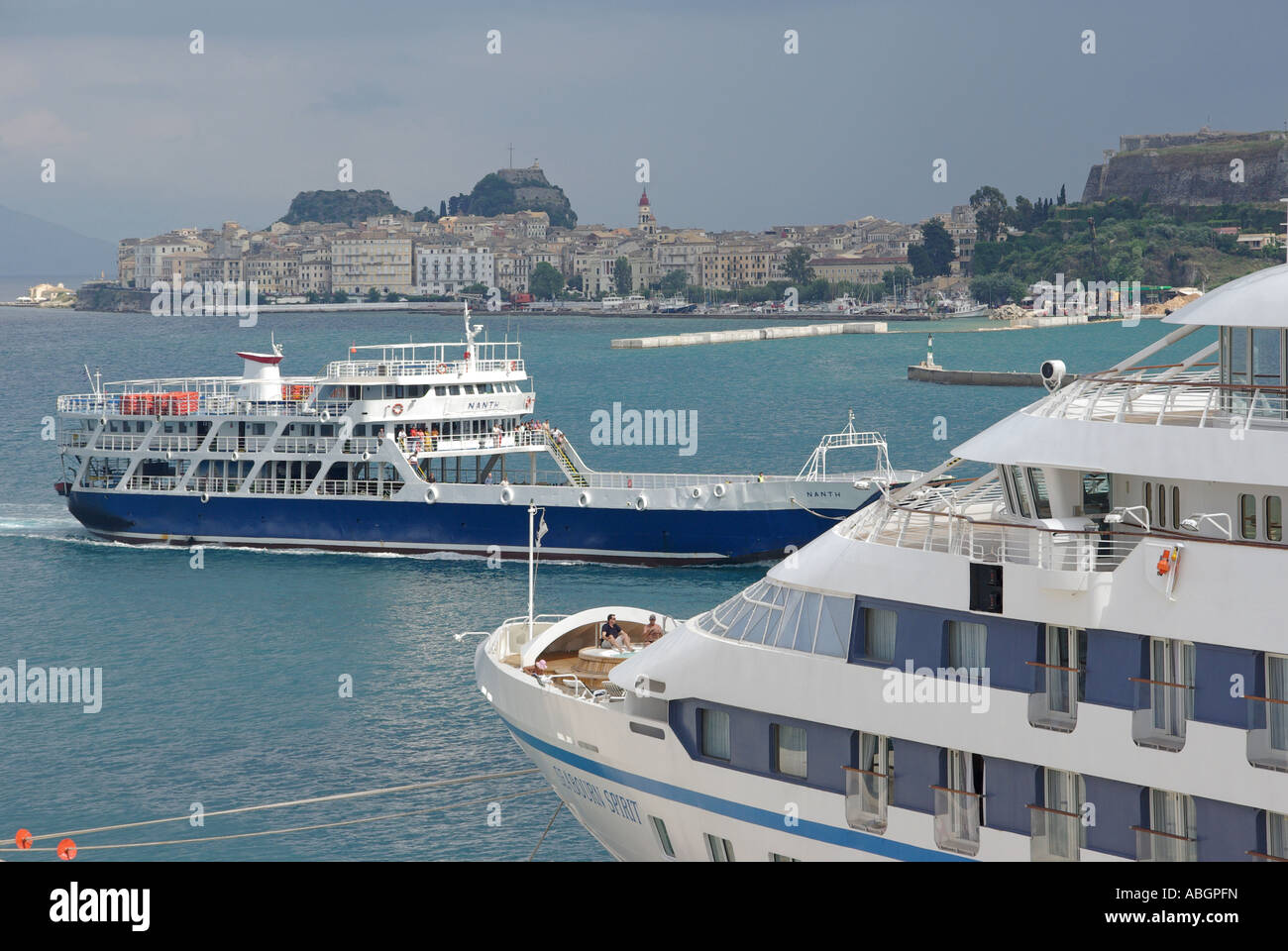 Corfu Greek island Corfu Town new port with cruise ship at moorings and views towards the Old Town Fort ferry boat Stock Photo