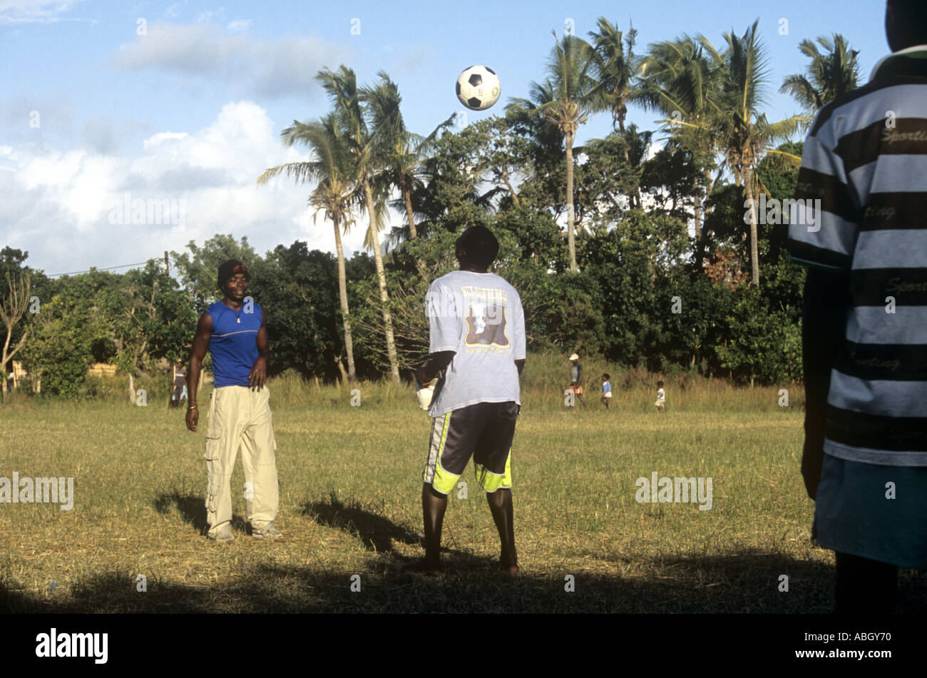 Three boys practicing soccer or football on Inhaca Island in bay of Maputo, Mozambique Stock Photo