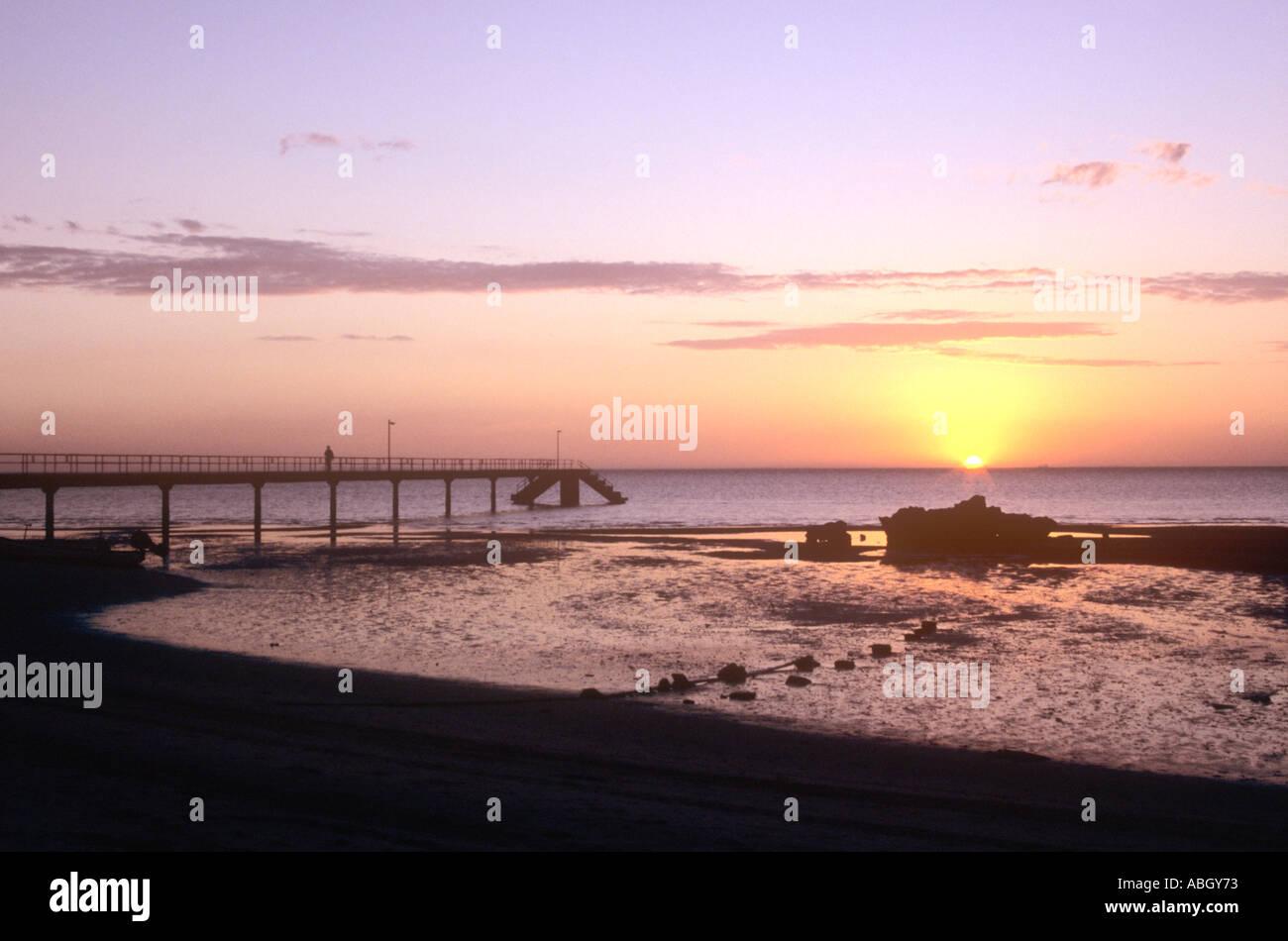 Sunset over bay of Maputo over pier on Inhaca Island near Maputo, Mozambique Stock Photo