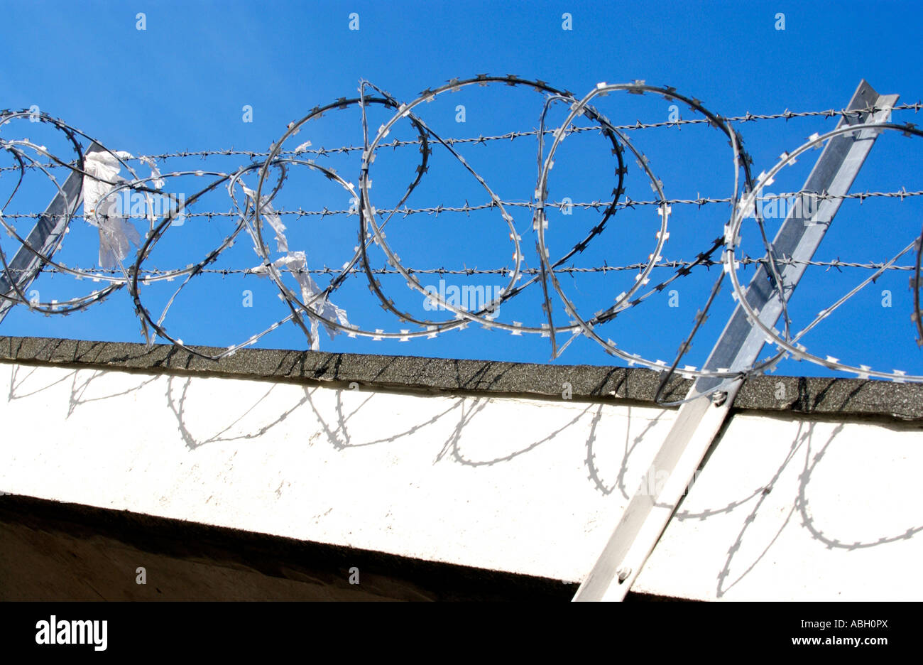 Razor wire security measures on run down shopping centre on Gurnos ...