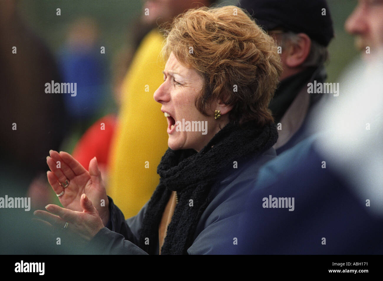 Woman shouting encouragement to players at a local rugby club match in Ebbw Vale Gwent Wales UK GB - Stock Image