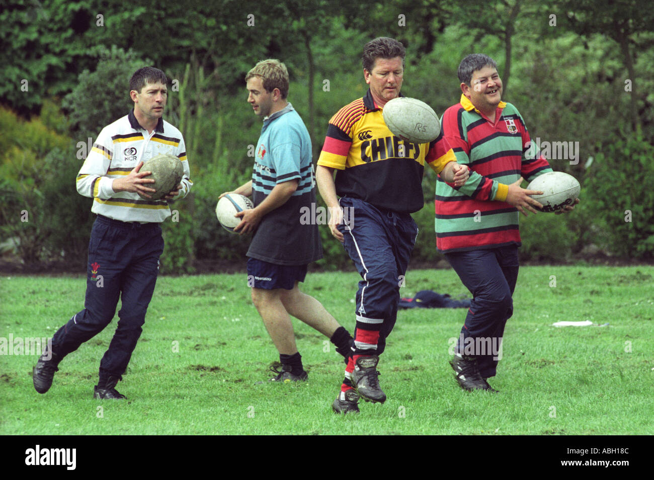 Men taking part in a Welsh Rugby Union coaching day to coach junior teams Gwent South Wales UK GB - Stock Image