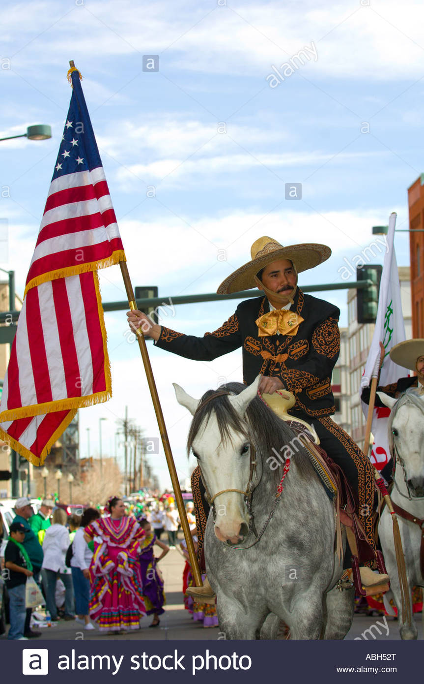 cae25810f320f A Mexican vaquero cowboy carries the American flag on horseback the St  Patrick s Day Parade