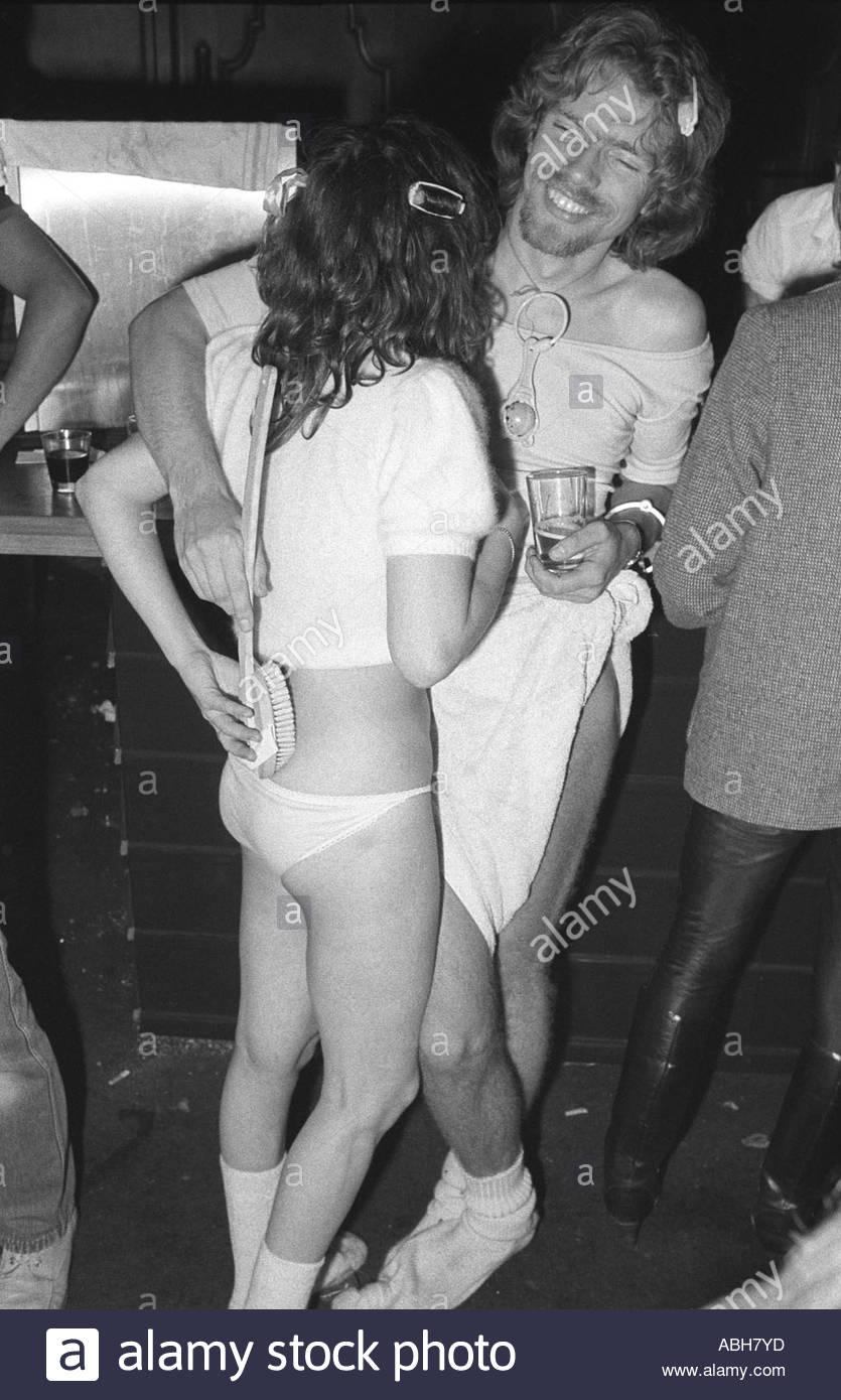 Couple enjoy a drink fancy dress party in a London nightclub. 1970s UK  HOMER SYKES - Stock Image