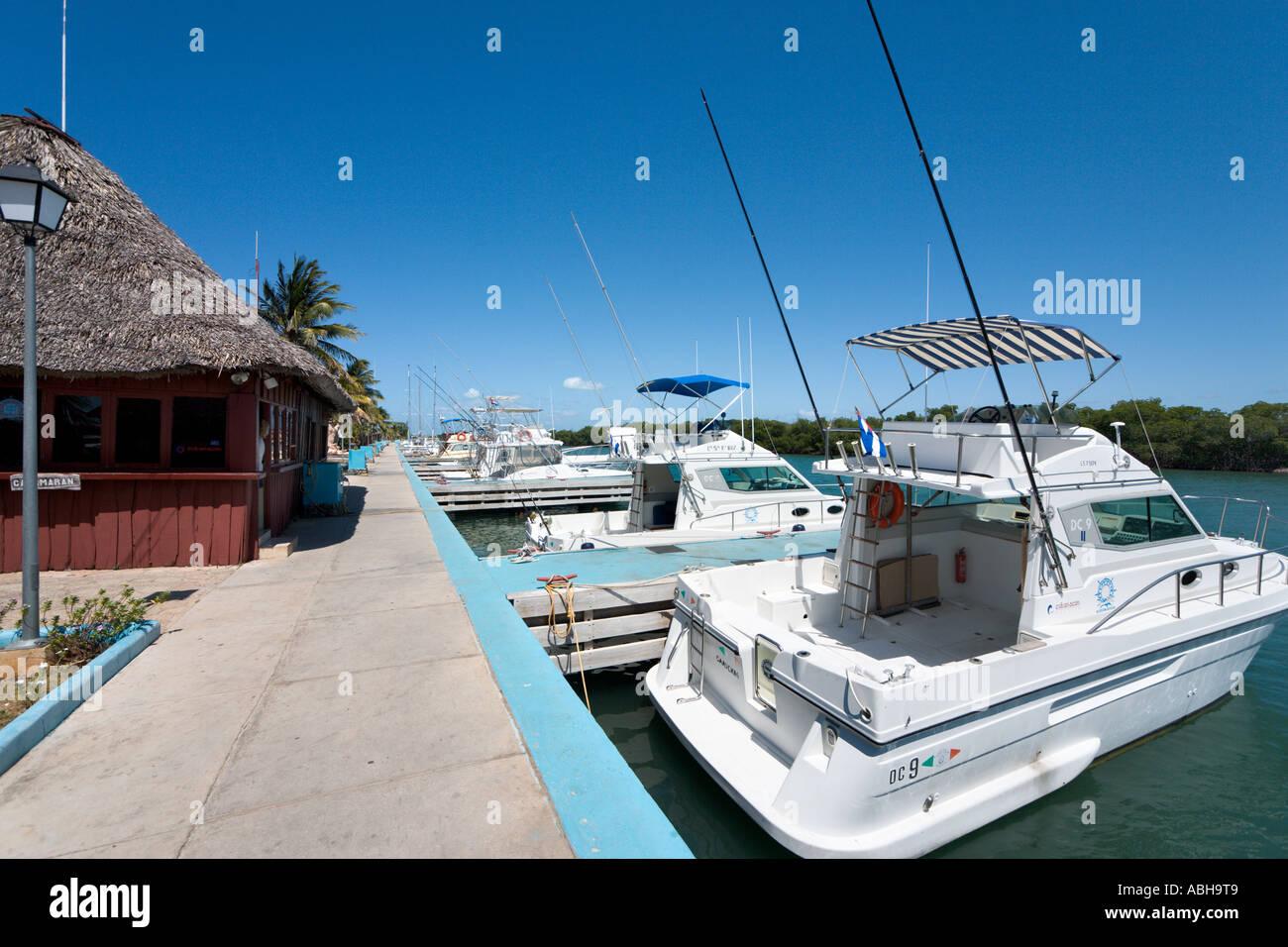 Fishing charter boats at Chapelin Marina in the resort area of Varadero, Cuba - Stock Image