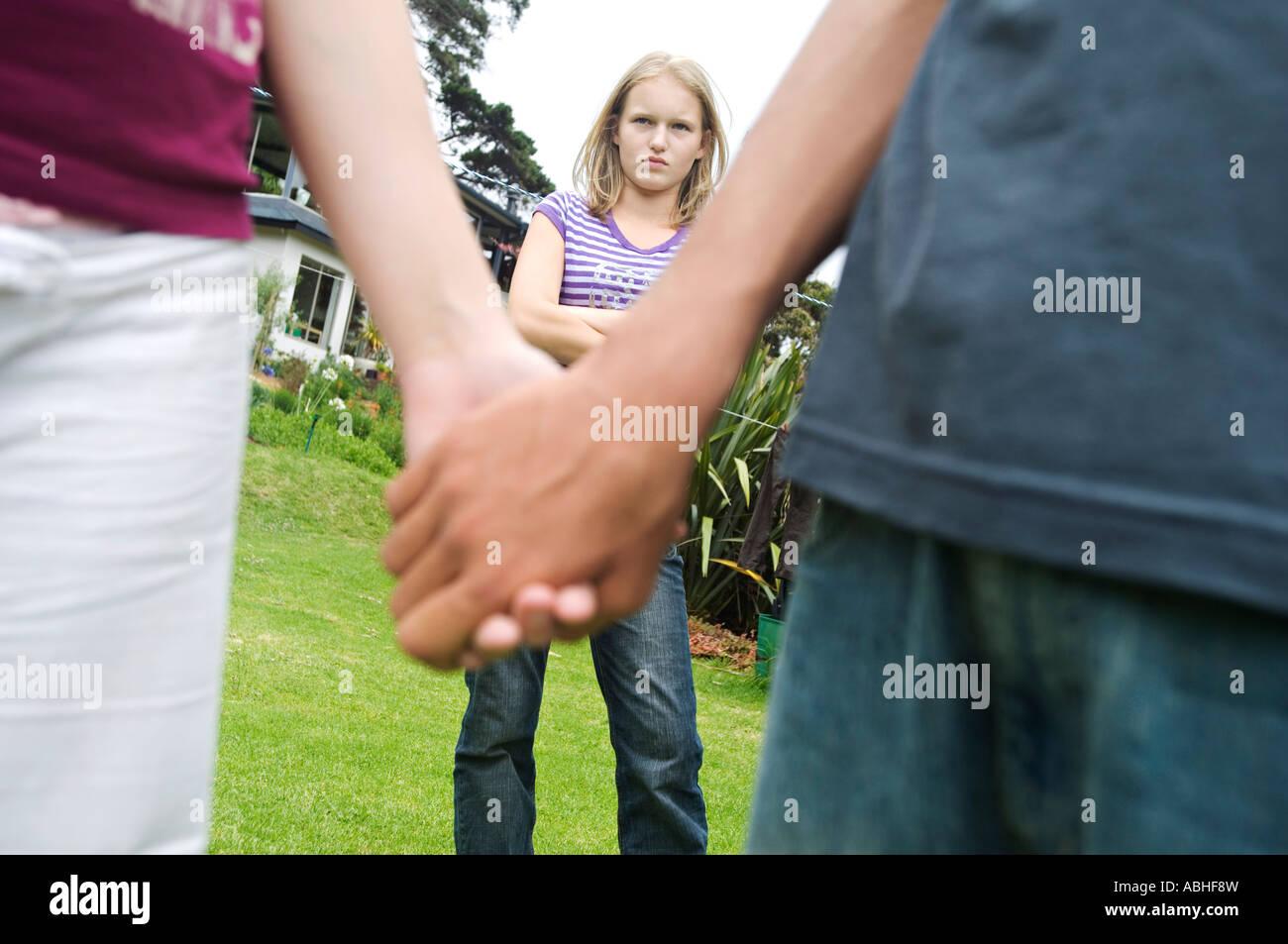 Hands holding teen