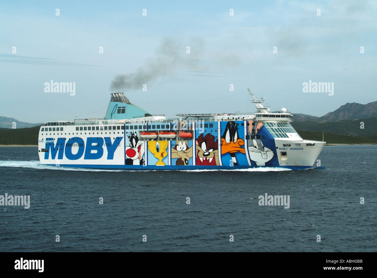 Olbia Sardinia Moby Lines Wonder ferry graphics depicting cartoon characters departing for open sea - Stock Image