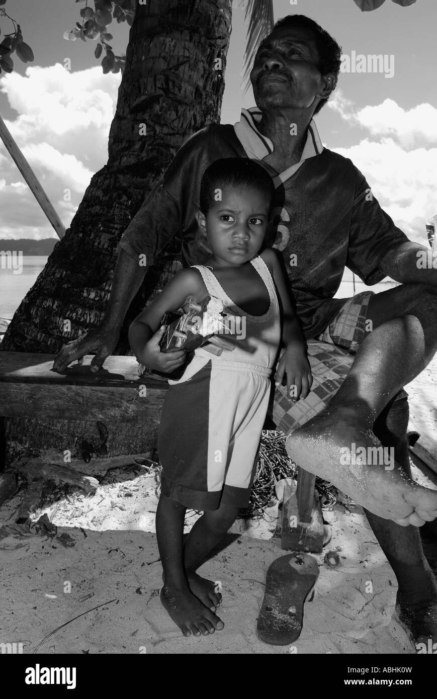 Man and son living on a small island in Raja Ampat, Indonesia - Stock Image