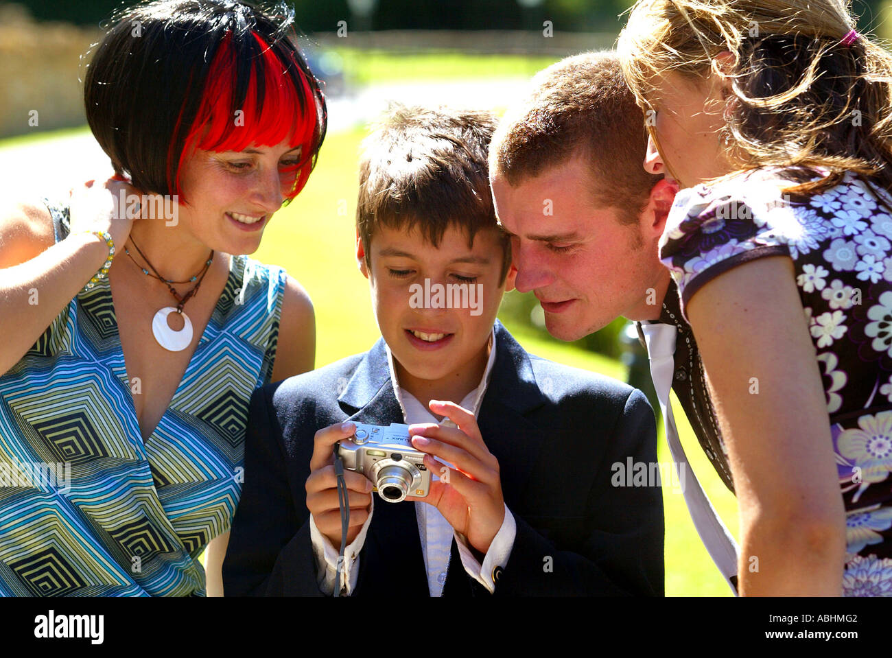 Viewing a digital image on the back of a camera - Stock Image
