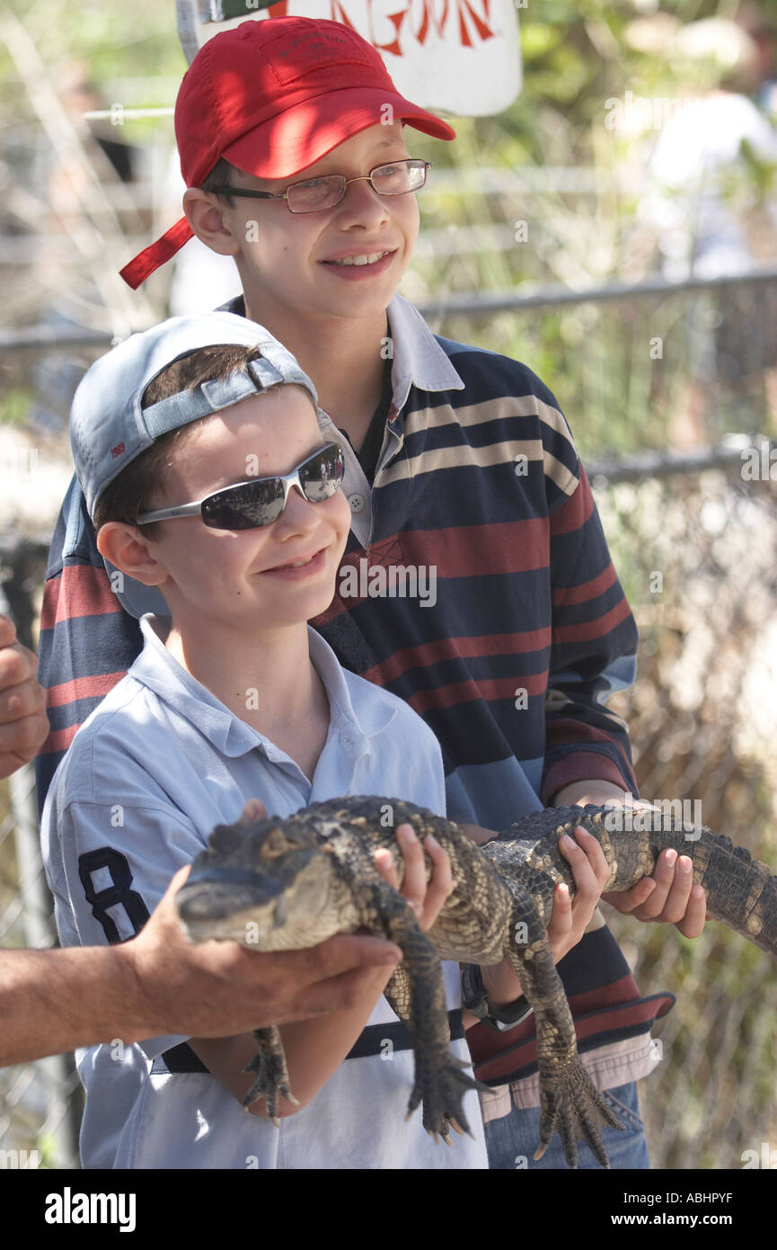5f5d1ffdf34c7 Kids getting proudly photographed with baby alligator in a show after  Tamiami Trail trip Everglades Florida