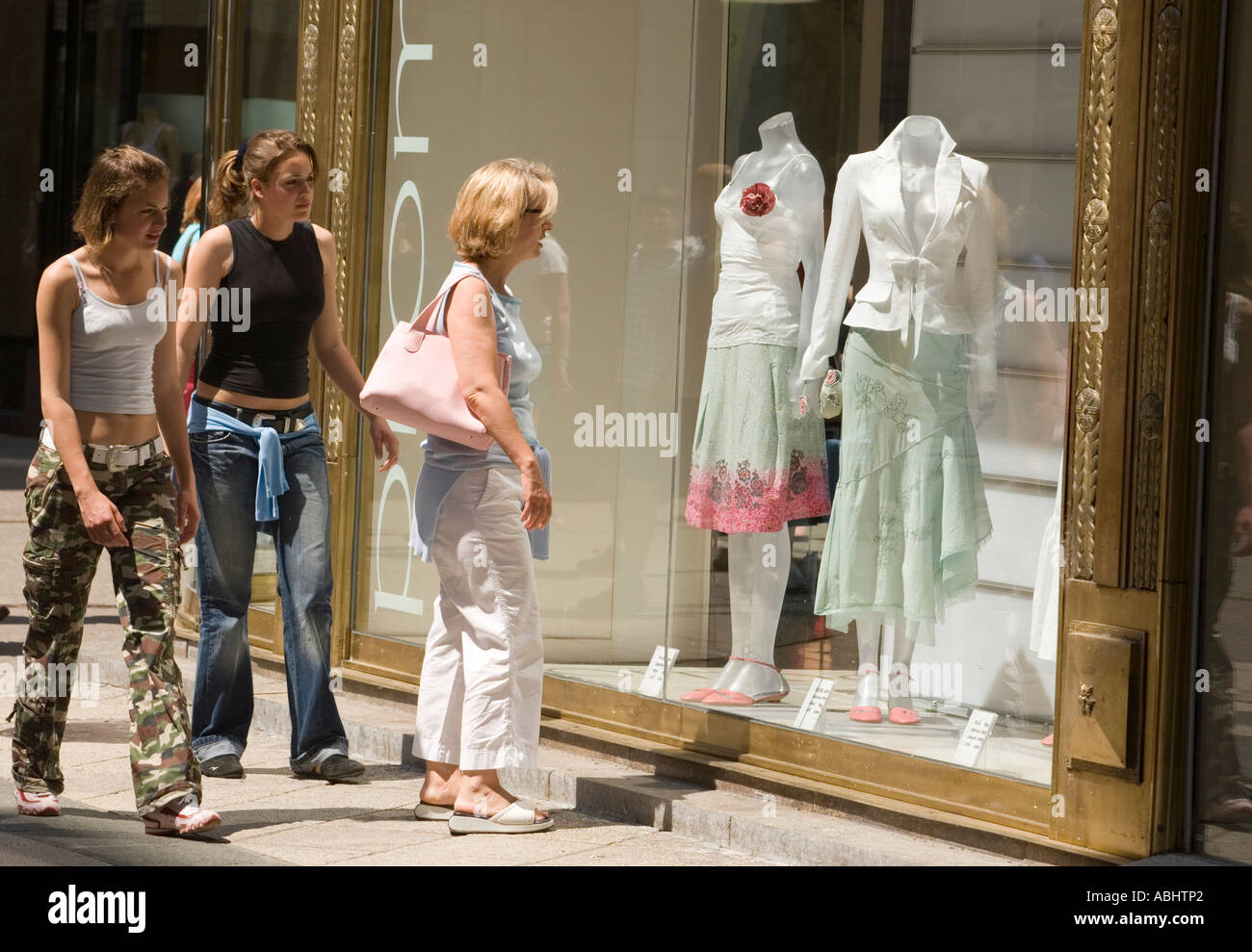 44de22fca653c Women in front of a boutique shop window at Vaci Street Pest Budapest  Hungary
