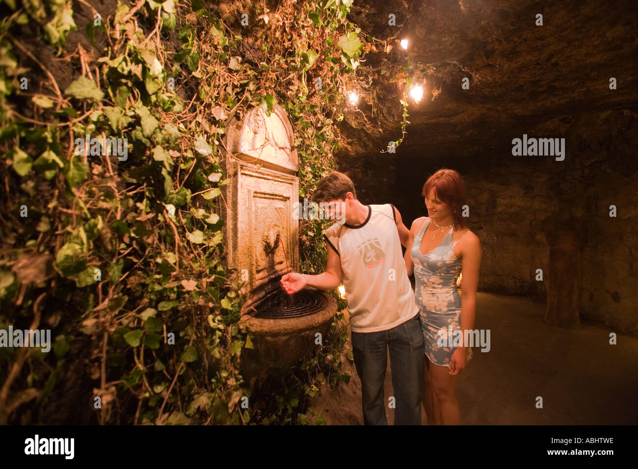 Couple next to the wine fountain in Buda Castle Labyrinth Buda Budapest Hungary Stock Photo
