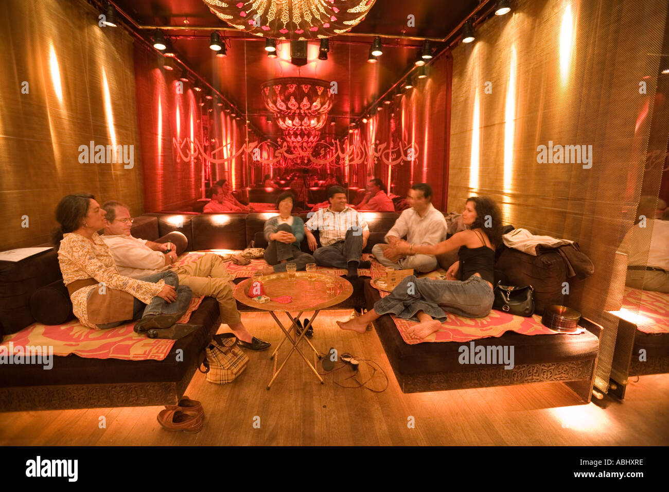 People relaxing on lounge at Nomads arabic style restaurant and club ...