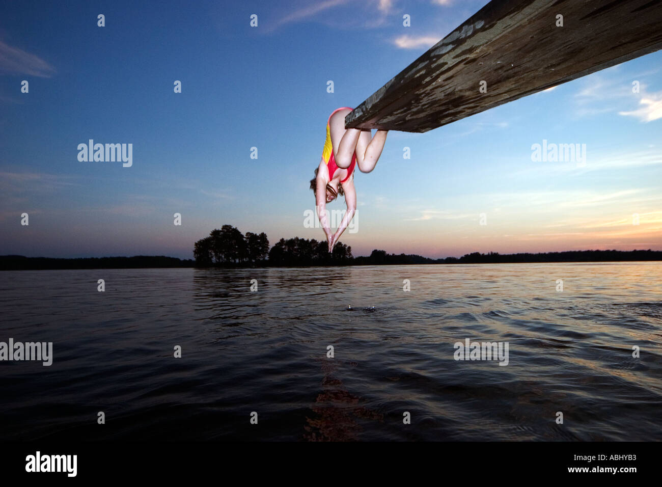 girl diving into the water - Stock Image