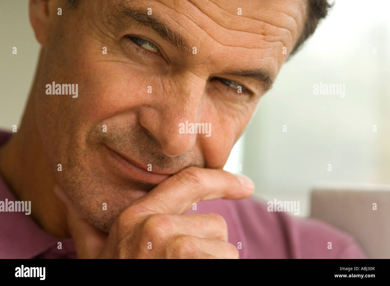Thoughtfull man's portrait, indoors - Stock Image