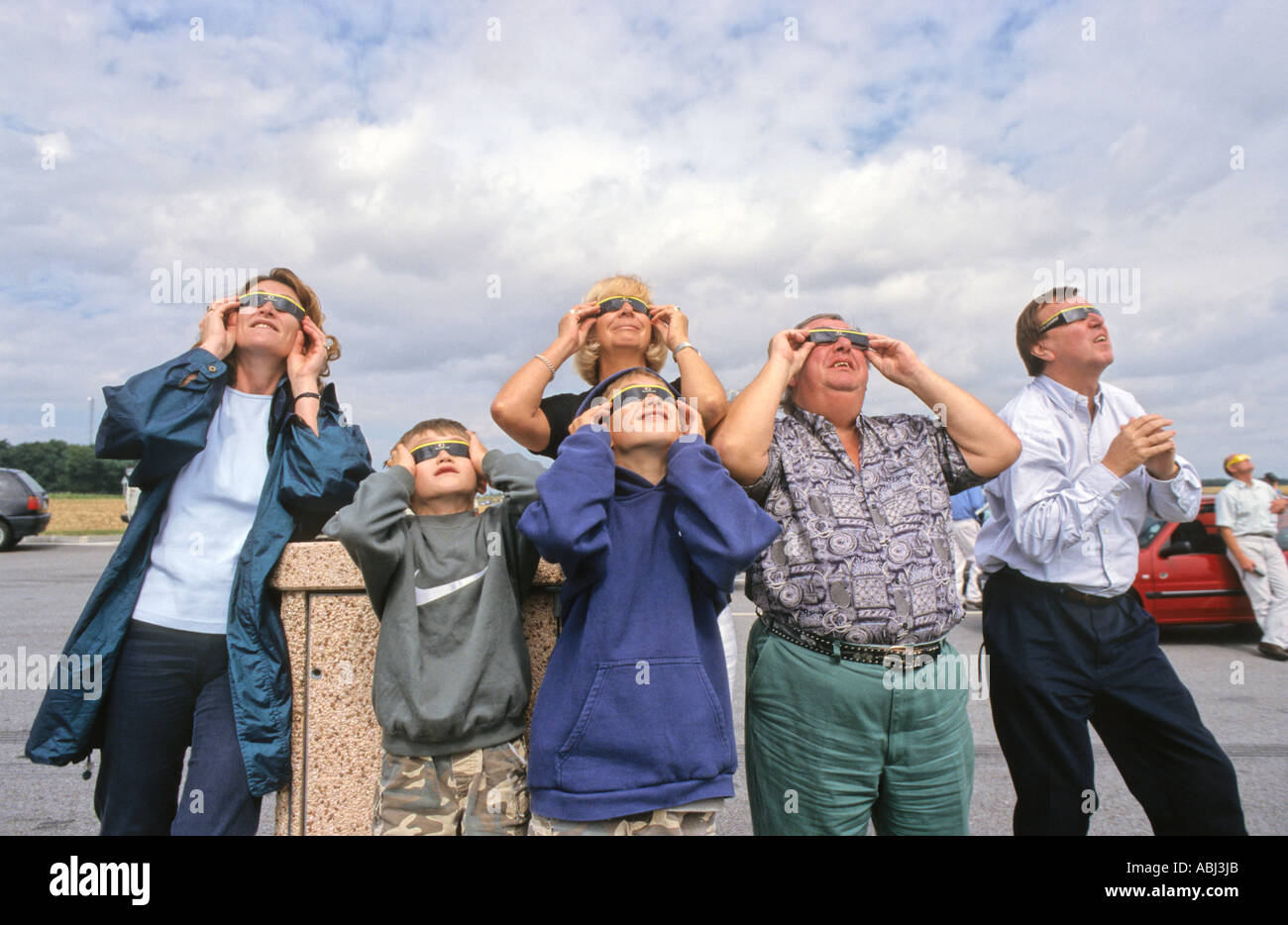 Watching the total solar eclipse in a motorway service station car park, Northern France, August 1999 - Stock Image