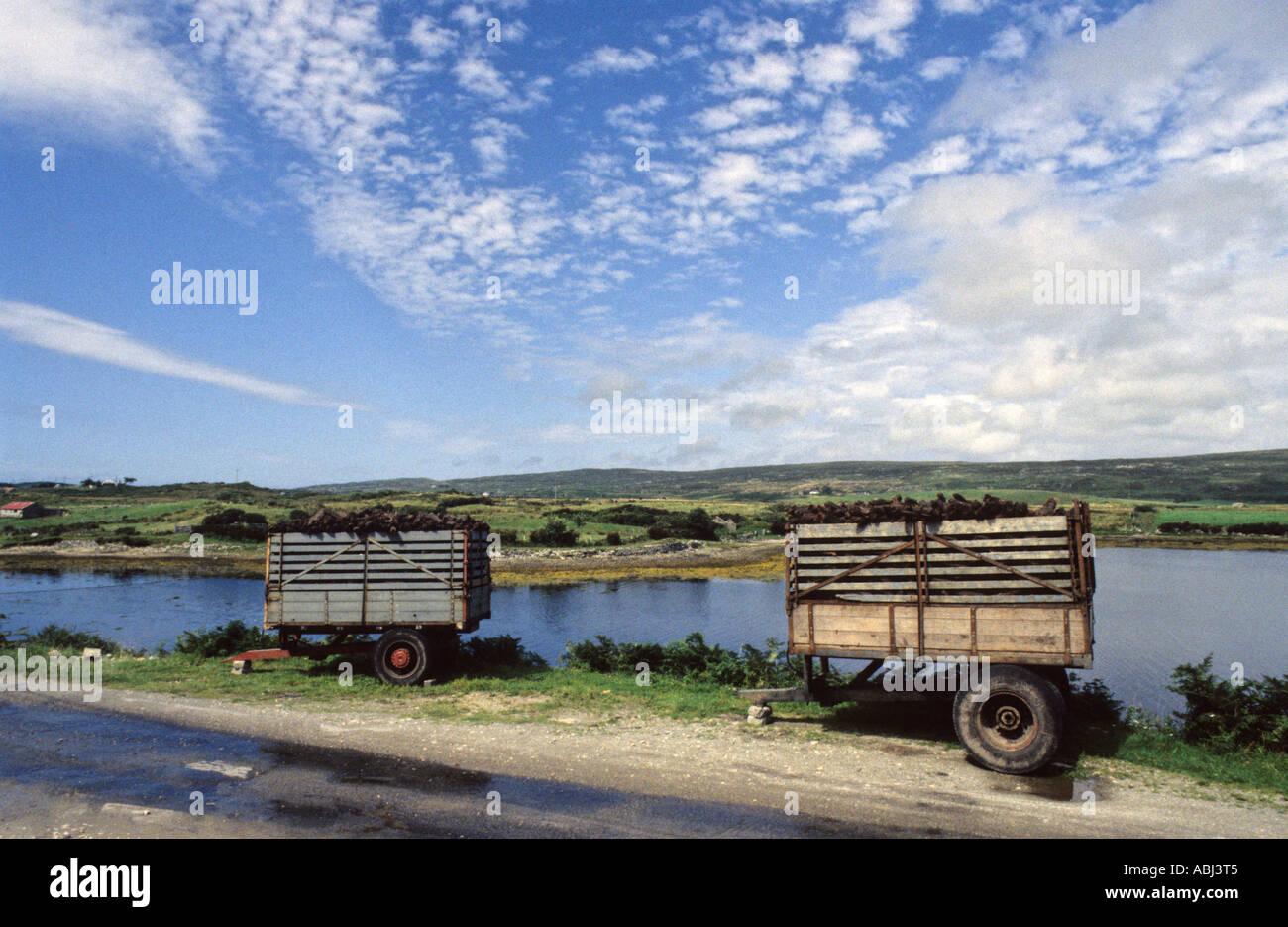 Trailers of turf, Connemara, County Galway, Republic of Ireland - Stock Image